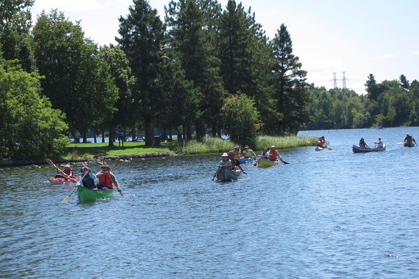 paddlers arriving at Mooney's Bay
